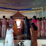 PRANAMS AT THE LOTUS FEET OF AMMA